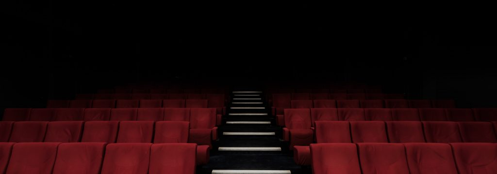 Image of theater seats which is a factor in producing a show. Photo by Felix Mooneeram.